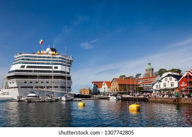 STAVANGER, NORWAY - AUGUST 14, 2018: Costa Favolosa cruise ship moored at Skagenkaien pier in Vagen Harbour of Old Stavanger, a popular tourist destination
