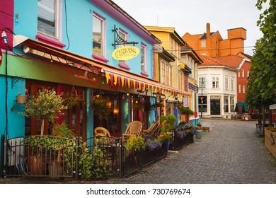 Stavanger, Norway - August 25 2017: The colorful restaurants in an old wooden buildings in rainy weather