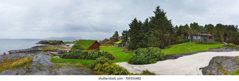 Stavanger, Norway - August 28 2017: Panoramic view of wooden houses on the stony shore in Flor and Flaere garden in inclement weather