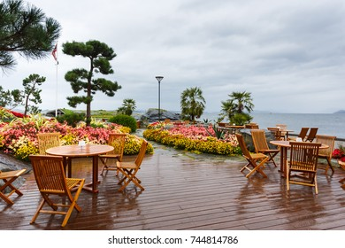 Stavanger, Norway - August 28 2017: Open air cafe in the Flor and Flaere garden, the most visible landmark in Rogaland county of Norway, rainy weather