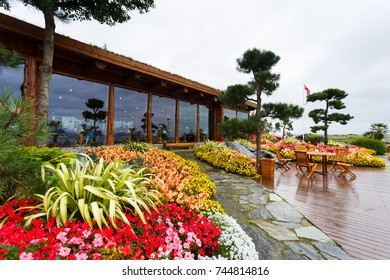 Stavanger, Norway - August 28 2017: Cafe in the Flor and Flaere garden, the most visible landmark in Rogaland county of Norway, rainy weather