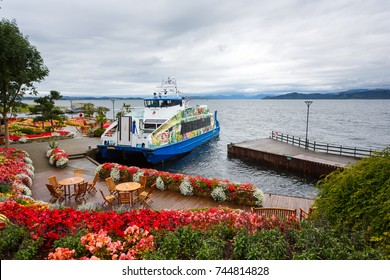 Stavanger, Norway - August 28 2017: Tourist ship is moored on the island Flor and Flaere garden, the most visible landmark in Rogaland county of Norway, rainy weather
