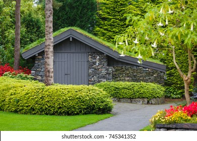 Stavanger, Norway - August 28 2017: Service house in the Flor and Flaere garden, the most visible landmark in Rogaland county of Norway, rainy weather