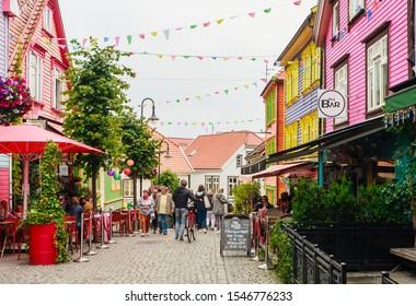 STAVANGER, NORWAY - JULE 18, 2019: Historic houses in colour street Ovre Holmegate in city centre of Stavanger, Rogaland, Norway