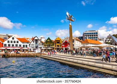 STAVANGER, NORWAY - JULY 15: Lot of tourists walking, shopping and sightseeing city center with many restaurants and pubs around, on July 15, 2015 in Stavanger, Norway.