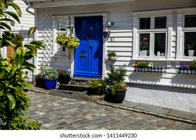 "Stavanger, Norway - July 23. 2015: This part of Stavanger is called ""GamleStavanger"" (Old Stavanger). It's the old part of the city. This is a typical entrance in this part of the city."