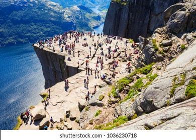 STAVANGER, NORWAY - JULY 23, 2017: Tourists at the Preikestolen or Pulpit Rock, famous tourist attraction near Stavanger, Norway. It is a cliff, rises above Lysefjord.