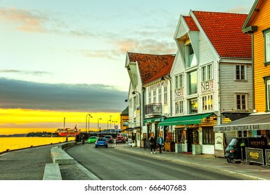 STAVANGER, NORWAY - OCTOBER 12, 2016: People at the quay port with many restaurants and pubs in the city centre of Stavanger. Stavanger is one of most famous cruise travel destinations in Europe.