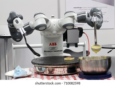 STAVANGER, NORWAY - SEPTEMBER 01, 2017: The robot YuMi from RobotNorge cooks pancakes at Create 2017, a festival for inventors and creators.