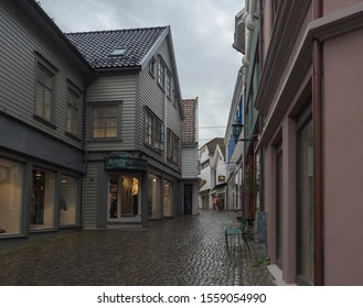 STAVANGER, NORWAY, SEPTEMBER 9, 2019 : street with Traditional wooden houses in Gamle Stavanger. Gamle Stavanger is a historic area of the city center of Stavanger. Rainy moody day. Travel and