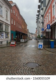 STAVANGER, NORWAY, SEPTEMBER 9, 2019 : street in city center of Stavanger with Traditional wooden houses in Gamle . Gamle Stavanger is a historic area of the city center of Stavanger. Rainy moody day