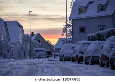 Stavanger Norway snow covered cars sunrise