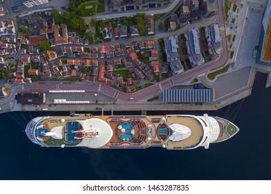 Stavanger, Rogaland / Norway, 07.19.2019: Evening cityscape of Stavanger sentrum, Norway. Cruise ship Explorer of the seas harbored in port of Stavanger.