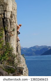 Stavanger, Rogaland / Norway - Summer 2014: Climbing in Trellskår at the outfall of Lysefjorden