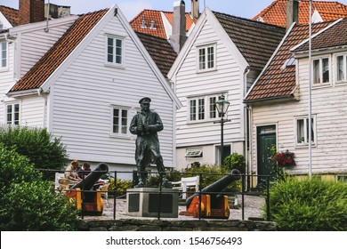 Stavanger/Norway - August 30, 2015: Statue of Vice Admiral Thore Horve with historic white wooden houses as background in Stavanger old town.