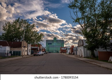 Stavely, Alberta -July 17, 2020: Main street in Stavely during the evening. The old grain elevator is visible at the end of the street.