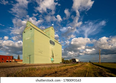 Stavely, Alberta -July 17, 2020: The last remaining grain elevator in Stavely, Alberta. Grain elevators once covered the prairies but most have been torn down or lost to fire.