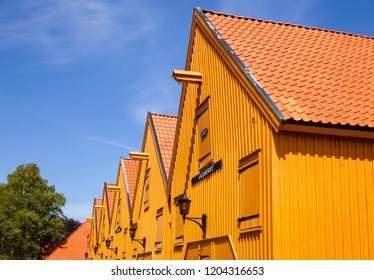 STAVERN, NORWAY - JULY 20, 2018: Ochre coloured historic barracks used as sloop and galley sheds at Fredriksvern Naval Base shipyard in Staverns Fortress