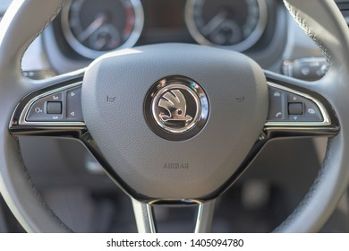 Stavropol Russia 21 05 2019 Skoda logo on a Steering Wheel - Hedgehog Indian Hat Arrow to Future. Classic interior design car Skoda and smart multi steering wheel.