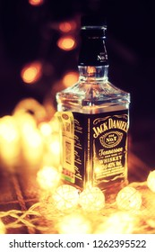 Stavropol, Russia - December 19, 2018:Jack Daniel's whiskey bottle near the ligths with shallow DOF. Jack Daniel's is a best America Whiskey in the world. And best selling. - Image