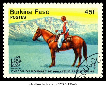 STAVROPOL, RUSSIA - October 19, 2018: stamp printed by Burkina Faso, shows Gauchos, Exhibition of philately. Argentina 1985, circa 1985