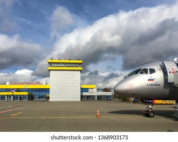 Stavropol, Russia. October, 2018: View of the runway at Stavropol Airport and the plane Sukhoi Superjet with pilot on a sunny day