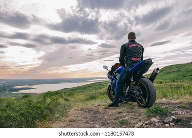 Stavropol/Russua - June 9 2018: Motorcycle and motorcyclist from Motoclub Blacksmiths MC STAVROPOL outside the city at sunset. The photo was tinted and has a slight noise to create a film photo effect