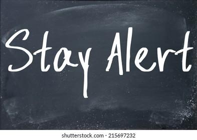 stay alert text write on blackboard