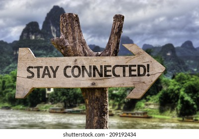 Stay Connected! wooden sign with a forest background