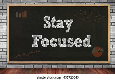 Stay Focused on brick wall and chalkboard background