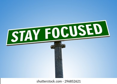 STAY FOCUSED word on green road sign