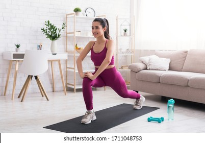 Stay home, stay active. Hispanic girl doing cardio workout in living room