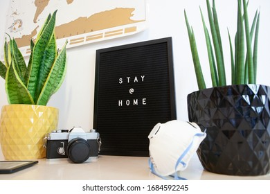 Stay at home message on black board