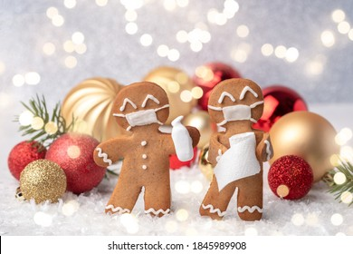 Stay home quarantine from Covid-19. Christmas gingerbread men with a masks - Shutterstock ID 1845989908