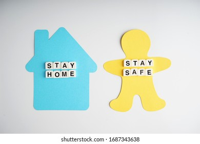 Stay home and stay safe safe during outbreak concept. stay safe & stay home alphabet with human and house from paper cutting