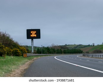 stay at home sign on the motorway