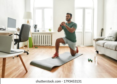 Stay motivated. Male fitness instructor showing exercises while streaming, broadcasting video lesson on training at home using laptop. Sport, online gym concept. Horizontal shot