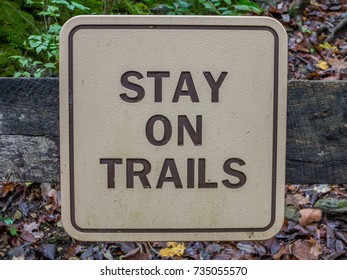 Stay on trails sign