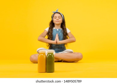 Stay positive and optimistic. Healthy way of life. Yoga training. KId girl sit meditate. Meditating practice. Good vibes. Peaceful meditating. Vegetarian smoothie drink. Learn meditating techniques.