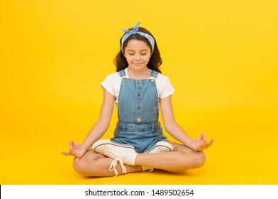 Stay positive and optimistic. Private space to relax. Yoga training. KId adorable girl sit meditate. Meditating practice. Life balance. Good vibes. Peaceful meditating. Learn meditating techniques.