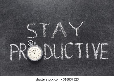 stay productive phrase handwritten on chalkboard with vintage precise stopwatch used instead of O