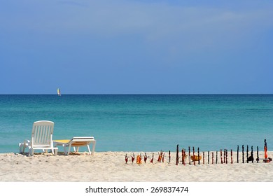 Stay and relax on the sandy beach shores of the ocean and carvings figures at Cuba.