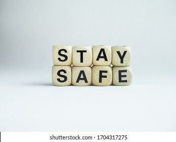 "Stay safe concept. Word ""Stay Safe"" isolated on white background. Stay at home, social media campaign for covid-19 or coronavirus pandemic prevention."