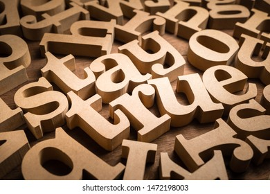 Stay True word found in the scattered wood alphabets on the table