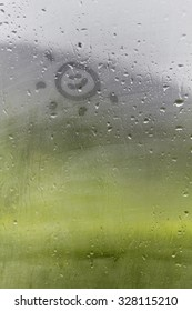 Staying positive - Smiley sun drawn on the foggy glass window on