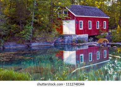 St.Catherines, Ontario / Canada - September 1, 2014: Morningstar Mill in summer with reflections in water.