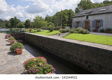 STE BARBE, FRANCE - JULY 8: Watch house at the lock on the canal of Le Blavet, which is popular path for bicycle tours on July 8, 2012 in Sainte-Barbe near Pont Augan in Brittany, France.