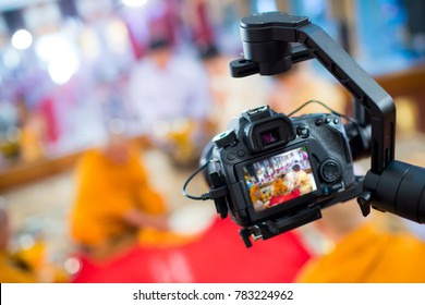 Steadicam with DSLR camera for video production are shooting movie in wedding ceremony. stabilize tool. stabilizer control machine. movie technology. image for background, objects and copy space.
