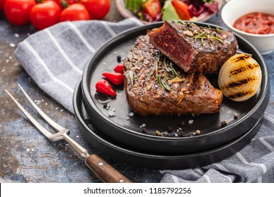 Steak beef. Beef steak medium with red pepper, aromatic herbs and fried onion.