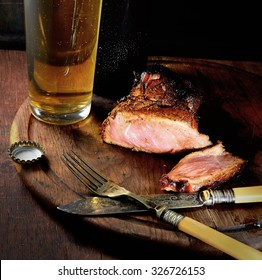 Steak  and beer on a wooden background